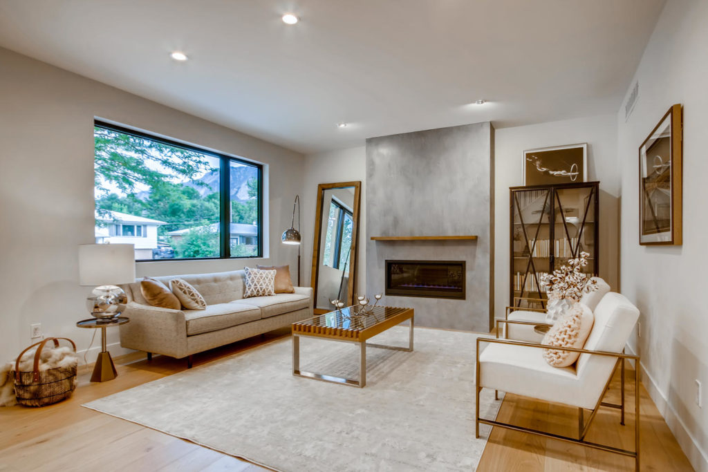 real estate photography - living room with concrete mantel