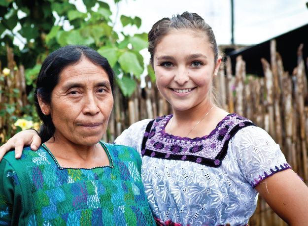 Image of a student wearing a local attire, Guatemala.