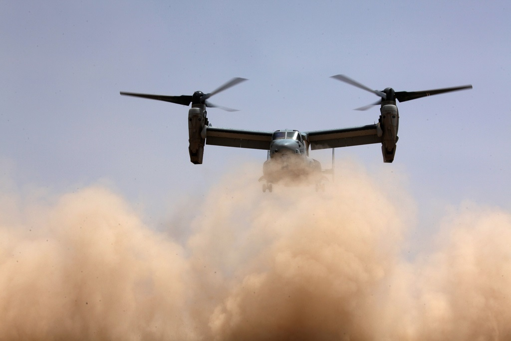 "An MV-22B Osprey lands in ""brown out"" conditions. Marine Corps photo"