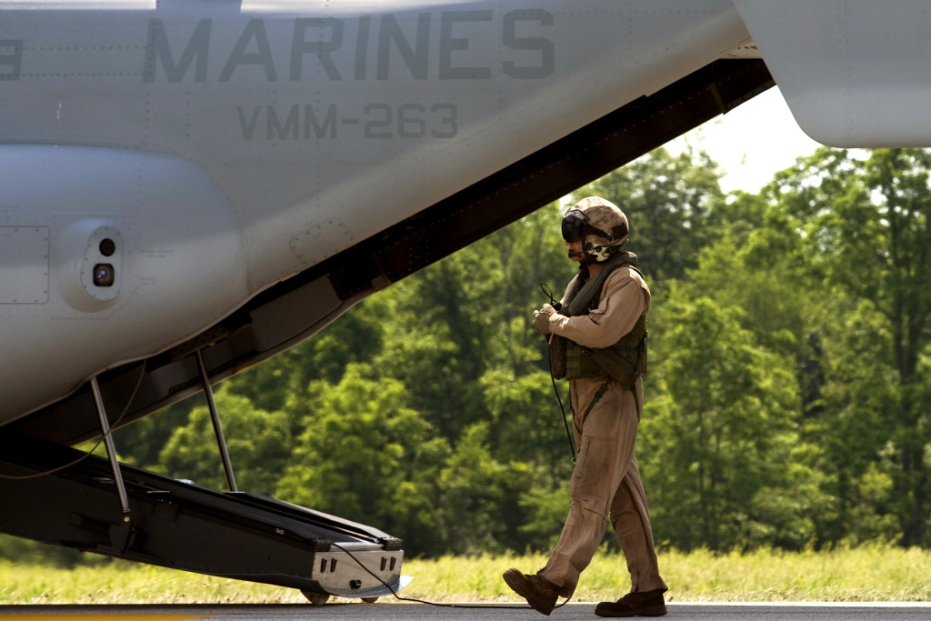 A U.S. Marine Corps crew chief inspects a V-22 in 2008. U.S. Army photo