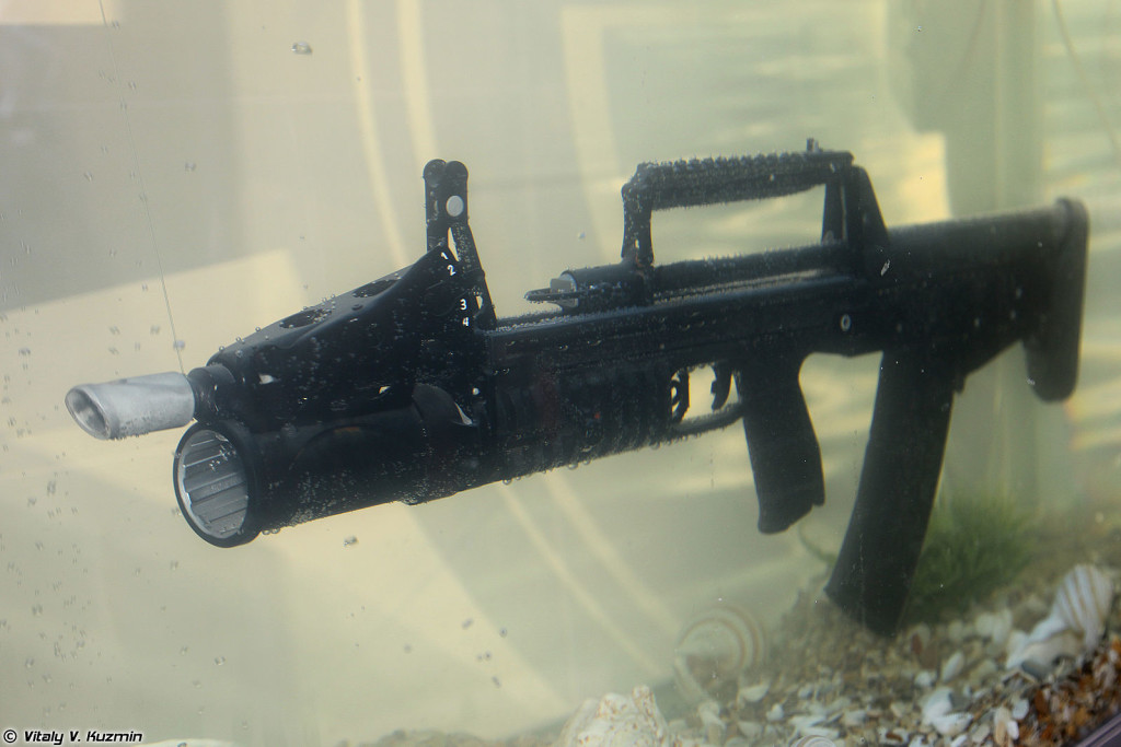ADS amphibious assault rifle on display in an aquarium at the 2013 Interpolitex International Homeland Security Exhibition in Moscow. Photo by Vitaly V. Kuzmin courtesy of Wikimedia Commons. https://commons.wikimedia.org/wiki/File:Interpolitex_2013_(536-2).jpg