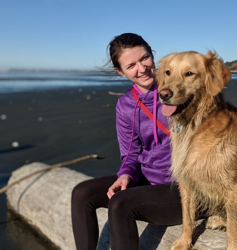Courtney with her dog at the beach.