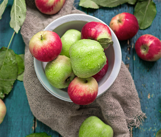 Bowl with green and red apples in it
