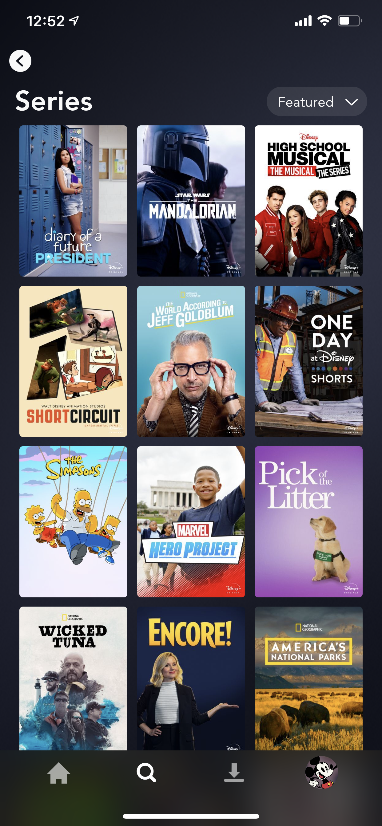 Example of App Design for iOS with the following features: content (image dominant), grid, navigation ~ menu, search, tab bar, card, icon button, dropdown. App by DisneyPlus (iPhone X)