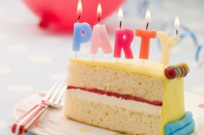 Party Candles on a Slice of Birthday Cake