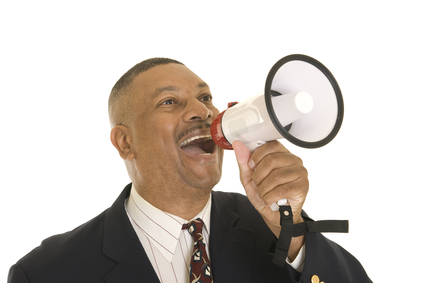 African American businessman shouting into a megaphone