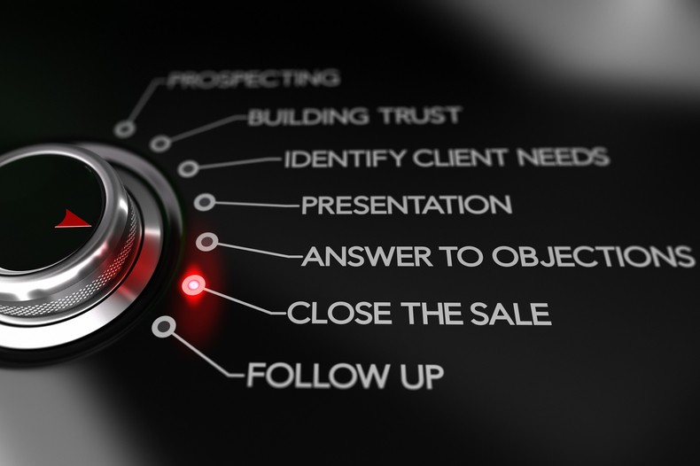 Switch button positioned on the text Close the sale, black background and red light. Conceptual image for illustration of sale process or selling tips.