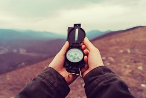 Hiker With A Compass