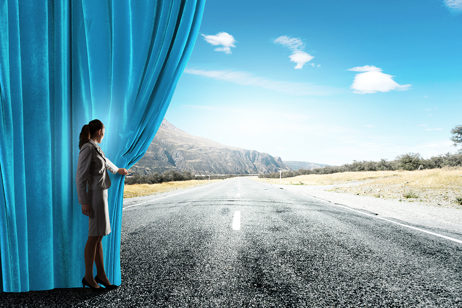 pulling back a curtain to reveal a road