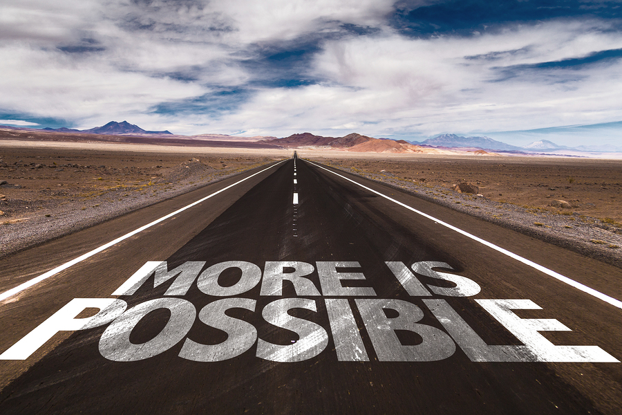 More is Possible written on desert road