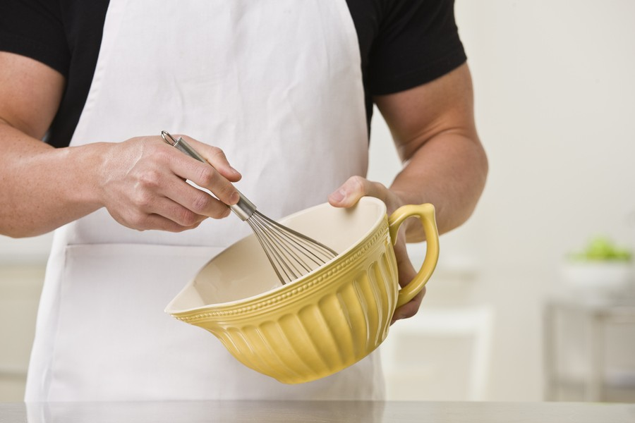 White muscular male with whisk and bowl. Horizontal.