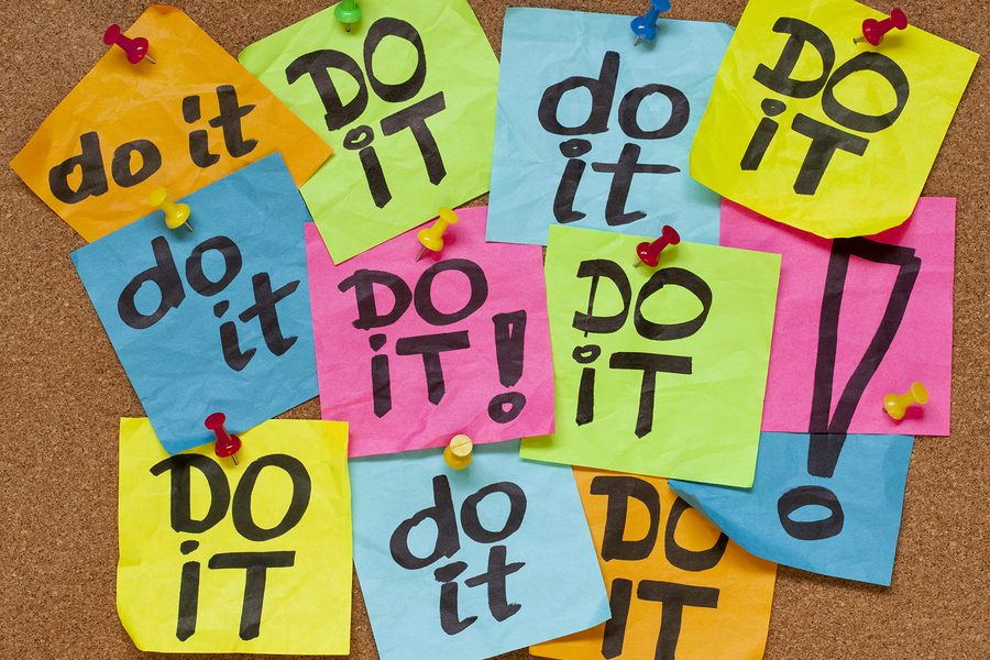 fighting procrastination concept - do it phrase on color sticky
