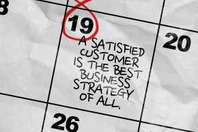 Concept image of a Calendar with the text: A Satisfied Customer