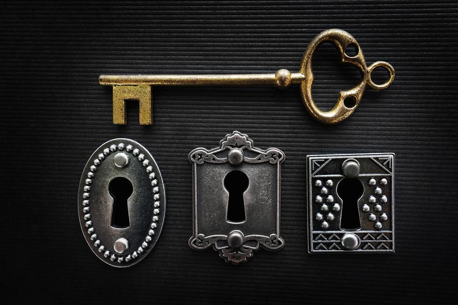 Three vintage door locks with gold key
