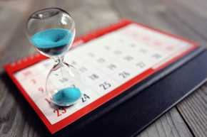 Hourglass and calendar - meeting deadlines concept