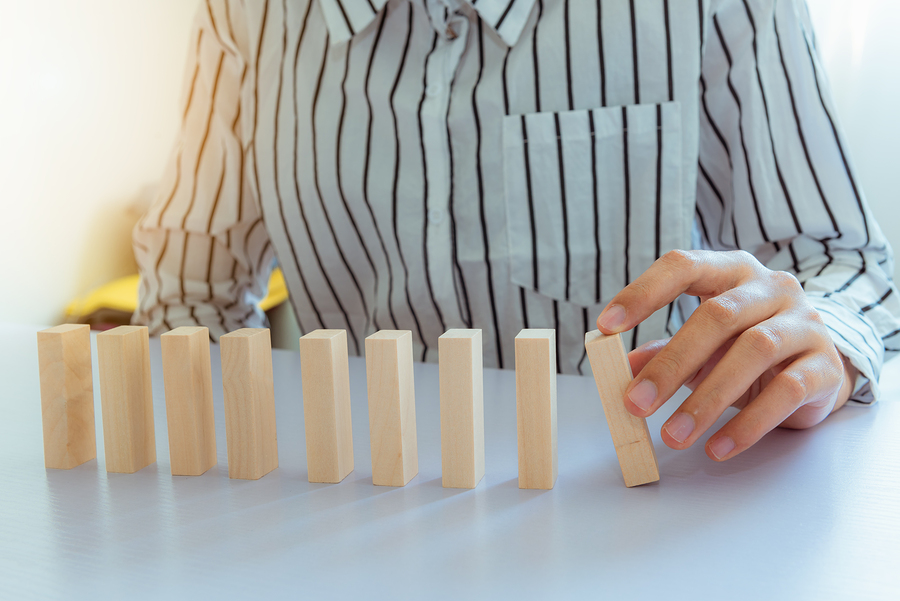 Woman Hand Action To Pushing Dominoes., Business And Dominoes Ef