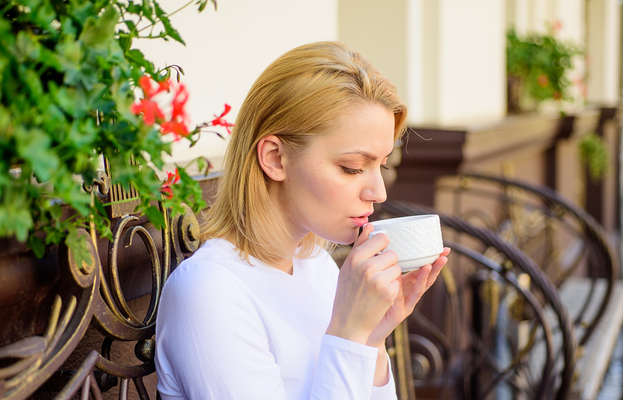 Woman Have Drink Cafe Terrace Outdoors. Mug Of Good Coffee In Mo