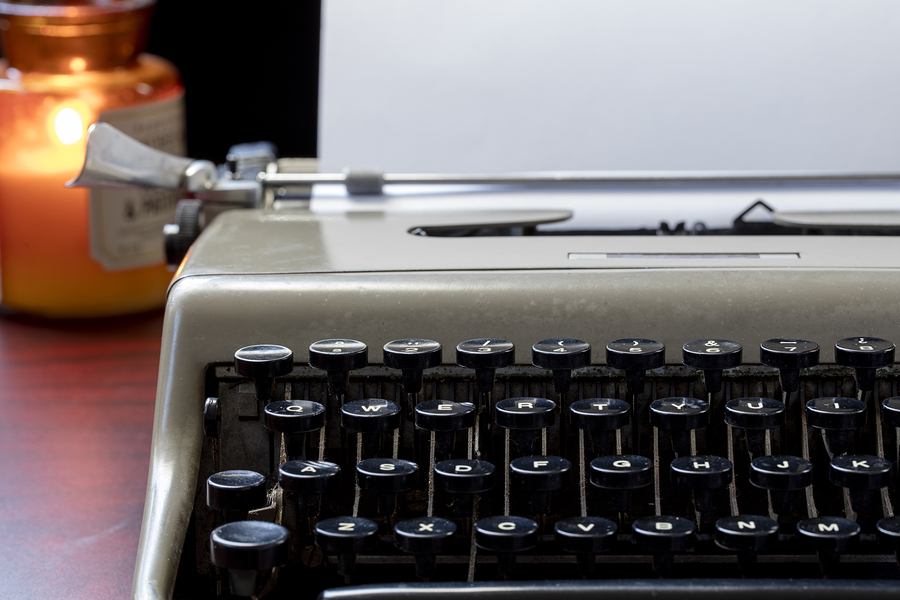 An old typewriter and candle - a special writing place