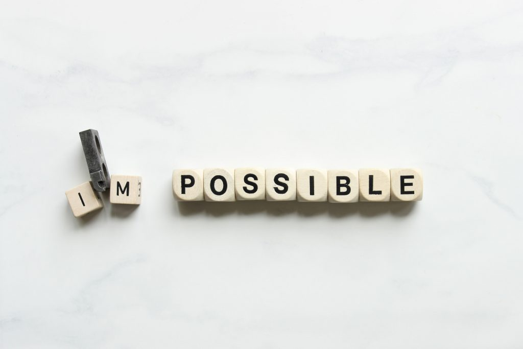 Letter dice spell out I'm Possible