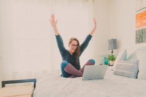 Woman excited about something on her laptop