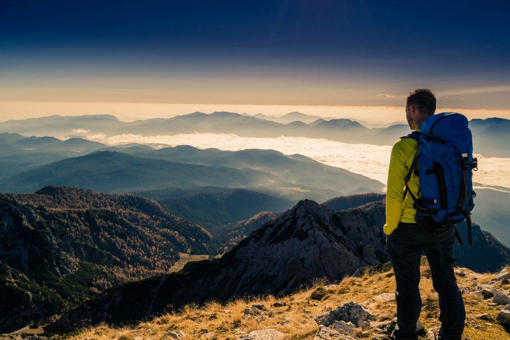 Backpacker-on-a-mountain-top_t20_EPN0vJ