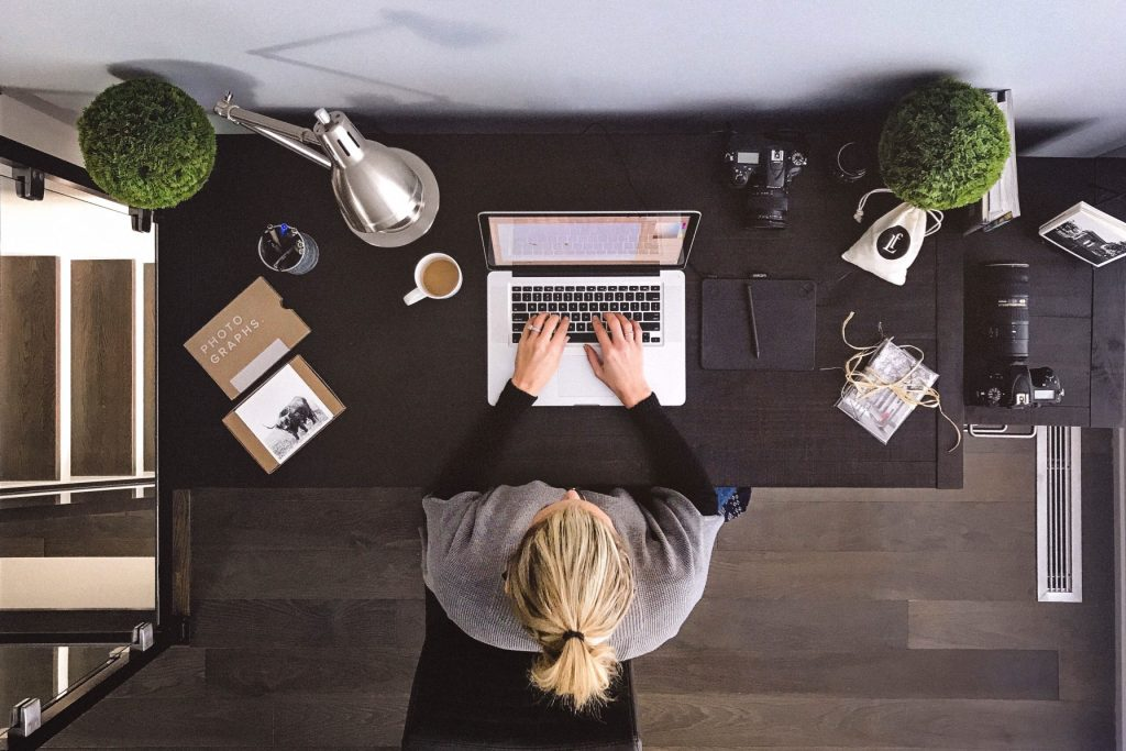 Woman working at a tidy desk