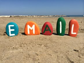 Email written in colorful paints on stones