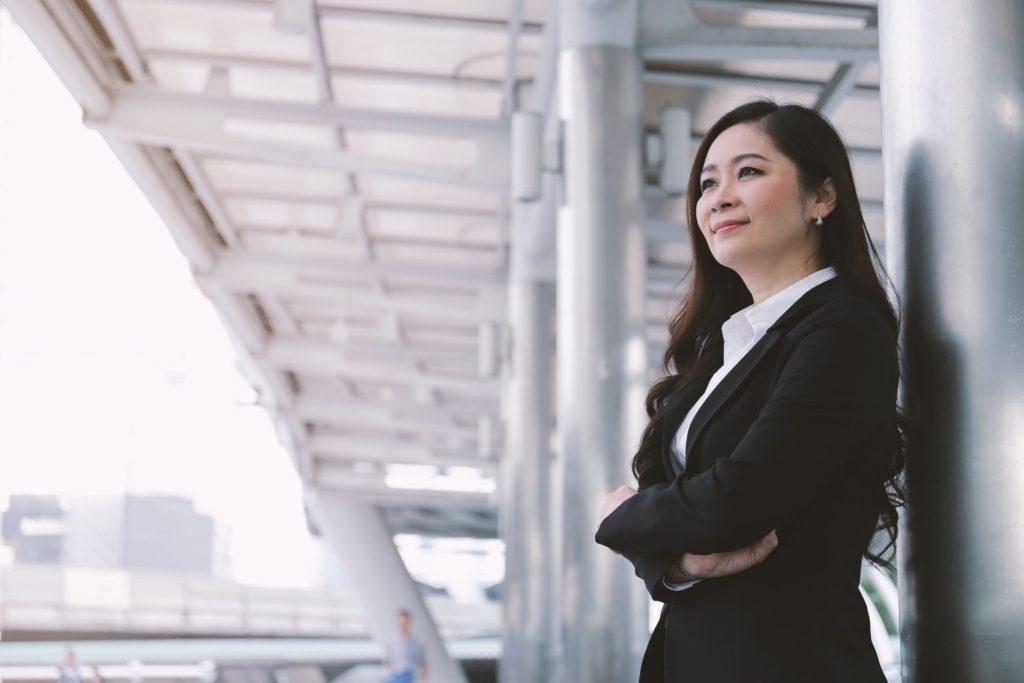 Asian-Businesswoman-Standing-by-Pillar