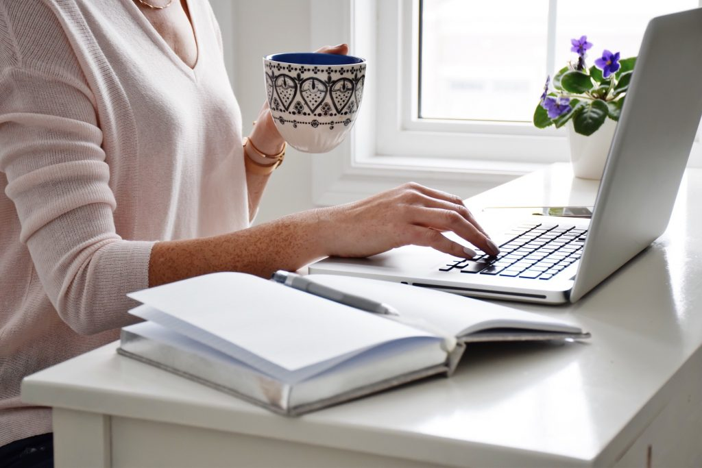 Woman at a laptop drinking tea