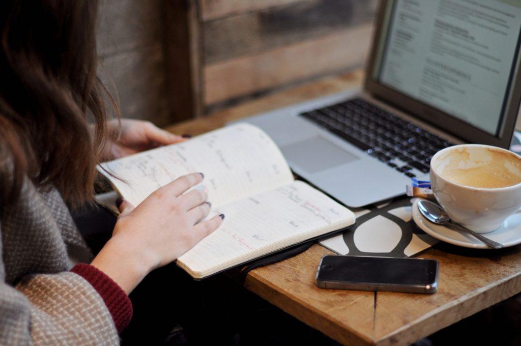 coffee-hands-planning-businesswoman-laptop-calendar-notebook-desktop-using-phone-using-laptop_t20_GGEvxR