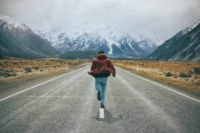 A man running on an empty road