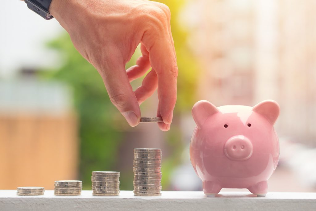 Getting Paid by Clients - Money Stacks by a Piggy Bank