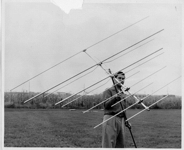 John Winegard, founder and member of the Consumer Electronics Assoc. Hall of Fame, with one of the first multi-channel Yagi antennas he invented