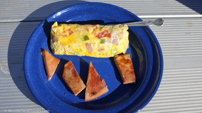 Denver omelet made in a bag served with boneless ham steak