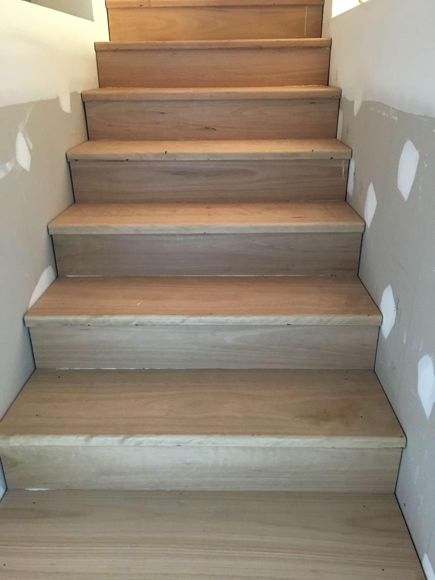 290x42 select grade Blackbutt treads for internal stairs. Custom made nosings for landings. Centennial Park, NSW