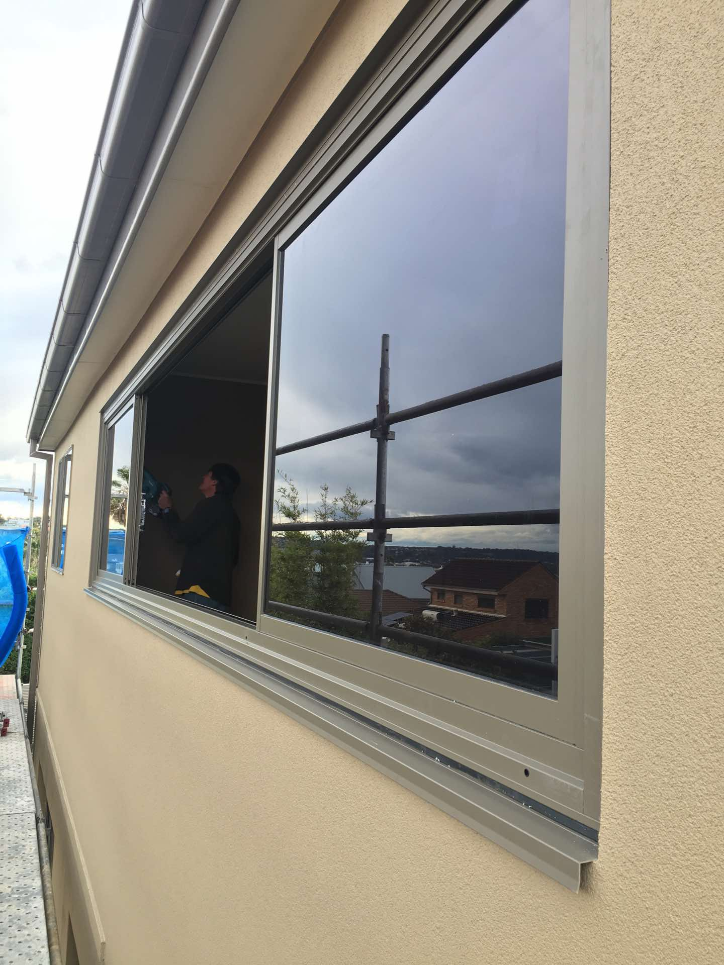 5.3m window installation to close up a covered verandah and make it watertight and useable all year round Dee Why, NSW