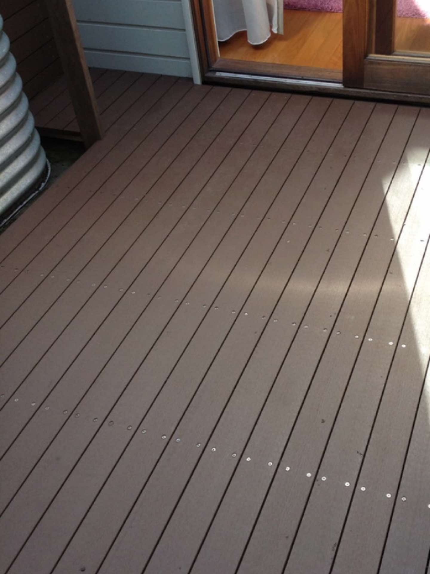 Internal courtyard that gets very little direct sunlight. Composite decking screwed down with stainless steel screws. Now a useable area Five Dock, NSW