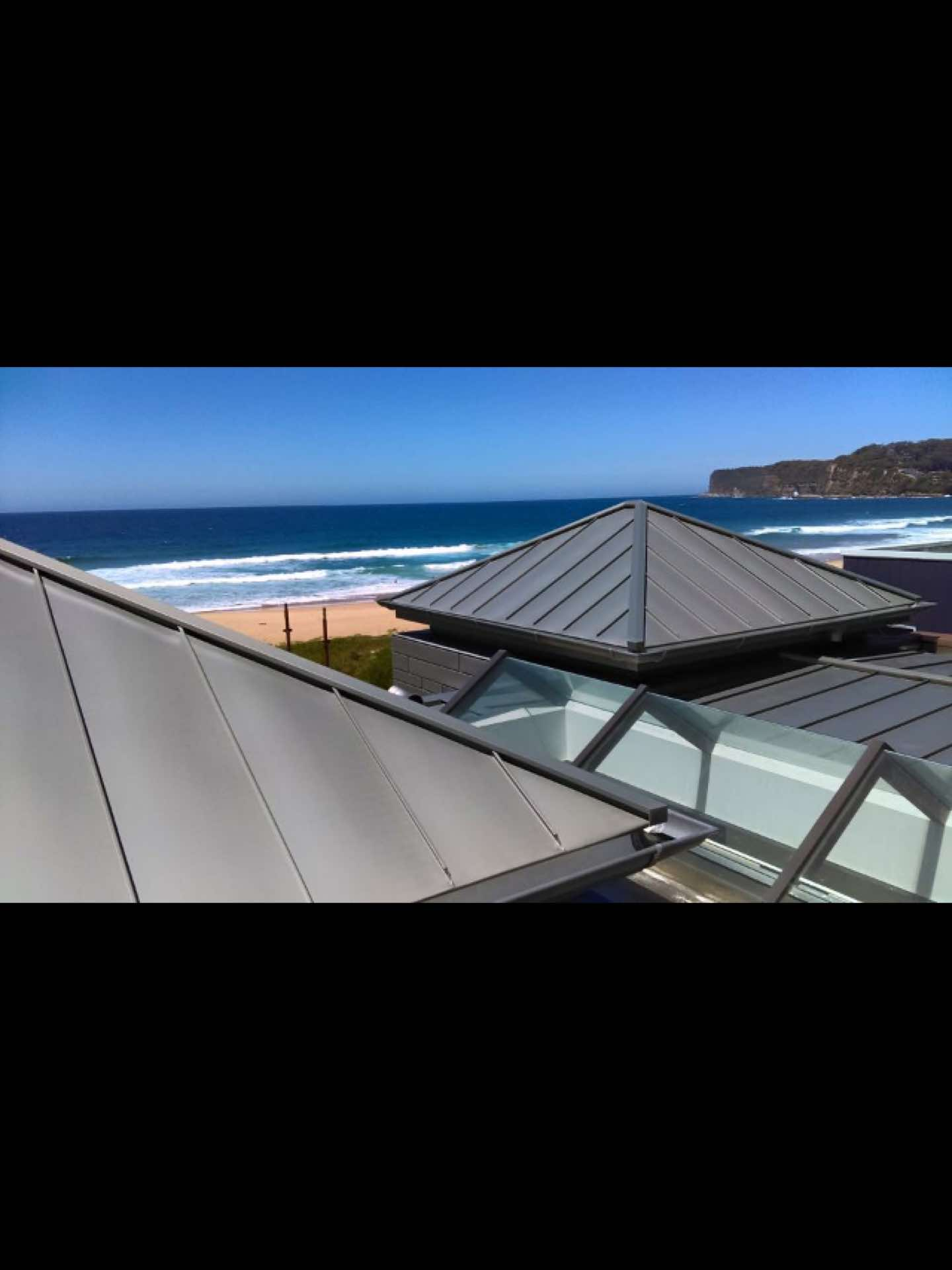 New beachfront build.  Steel frames roof covered with plywood, membrane and clad in zinc North Avoca, NSW