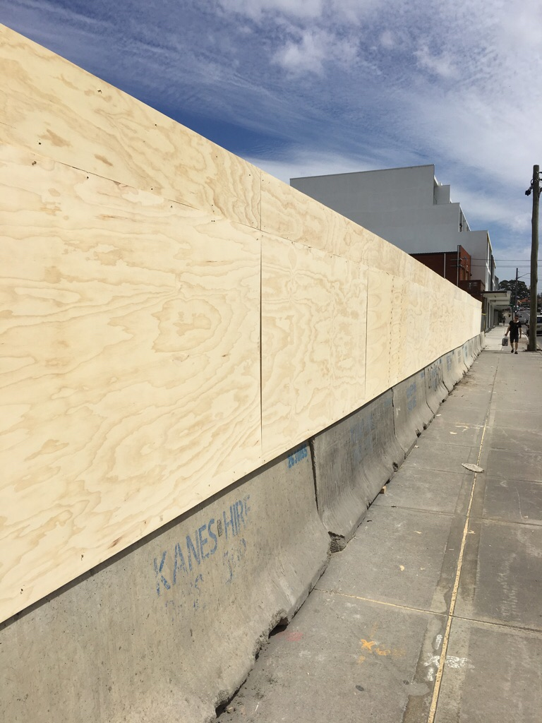 75m of timber hoarding on top of jersey curbs  Hurlstone Park, NSW