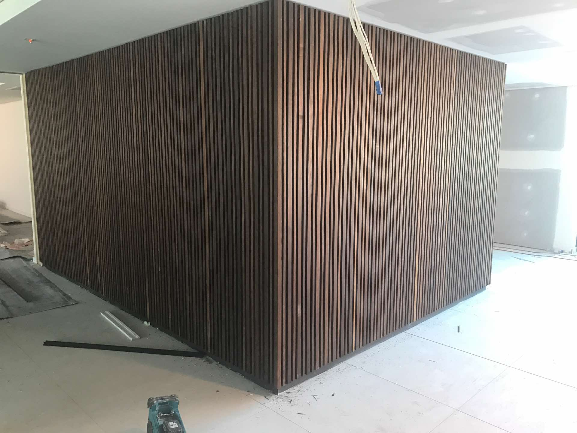 Installation of hardwood feature screens to lobby's Mascot, NSW