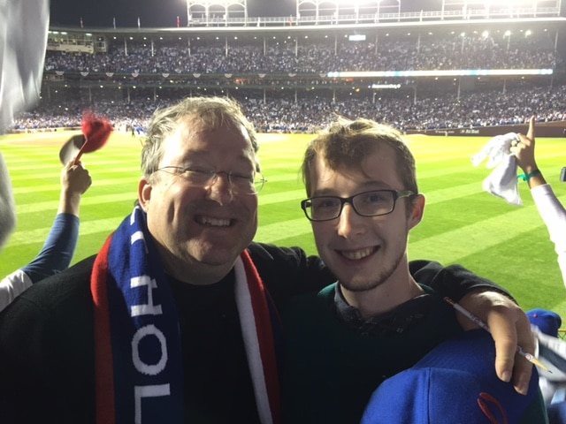 Brehmer's new favorite memory at Wrigley Field: sitting in the bleachers with his son when the Cubs beat the Cardinals in the NLDS in 2015. (Courtesy Lin Brehmer)