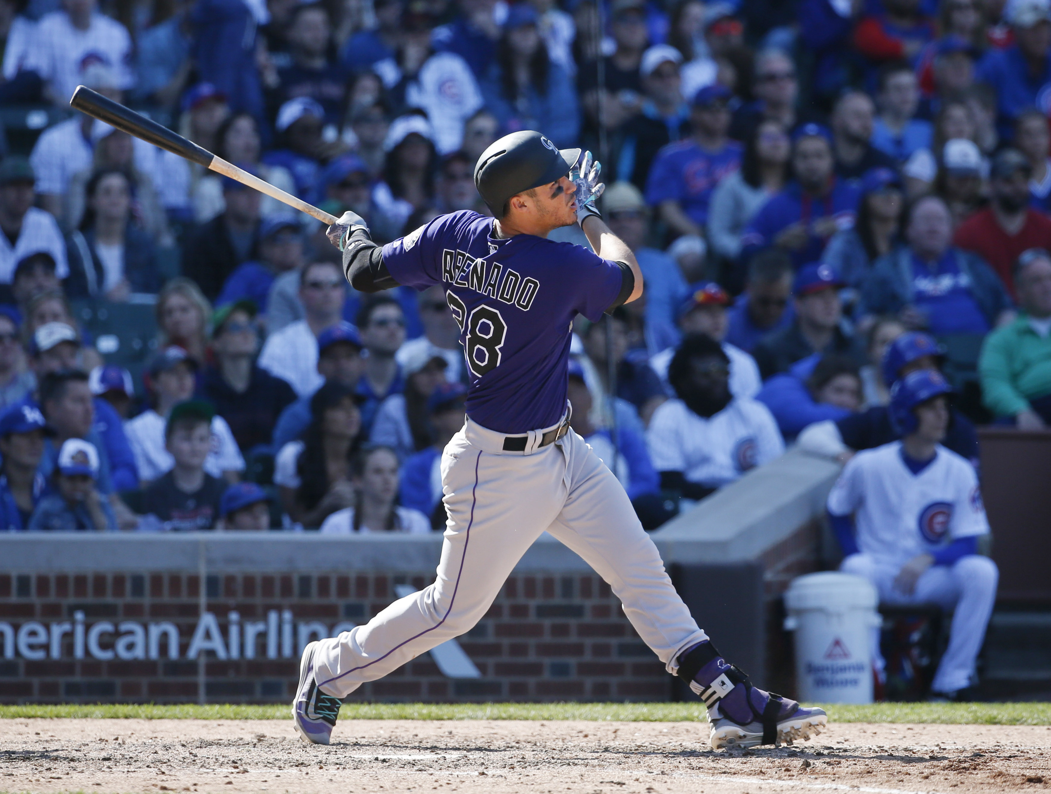 Apr 17, 2016; Chicago, IL, USA; Colorado Rockies third baseman Nolan Arenado (28) hits a solo home run during the ninth inning against the Chicago Cubs at Wrigley Field. Mandatory Credit: Kamil Krzaczynski-USA TODAY Sports