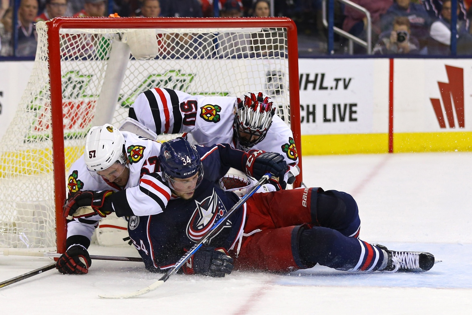 ; Columbus Blue Jackets right wing Josh Anderson (34) collides with Chicago Blackhawks defenseman Trevor van Riemsdyk (57) and goalie Corey Crawford (50) in net in the second period at Nationwide Arena. Mandatory Credit: Aaron Doster-USA TODAY Sports