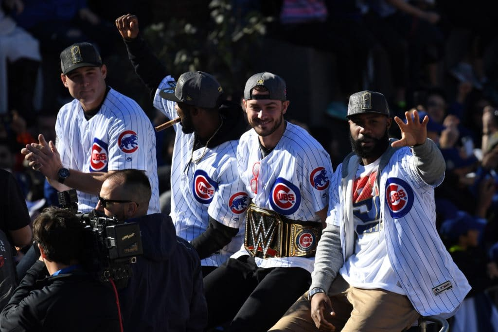 Chicago Cubs first baseman Anthony Rizzo and center fielder Dexter Fowler and third baseman Kris Bryant and right fielder Jason Heyward celebrate during their World Series parade outside of Wrigley Field on Addison Street. Mandatory Credit: Patrick Gorski-USA TODAY Sports