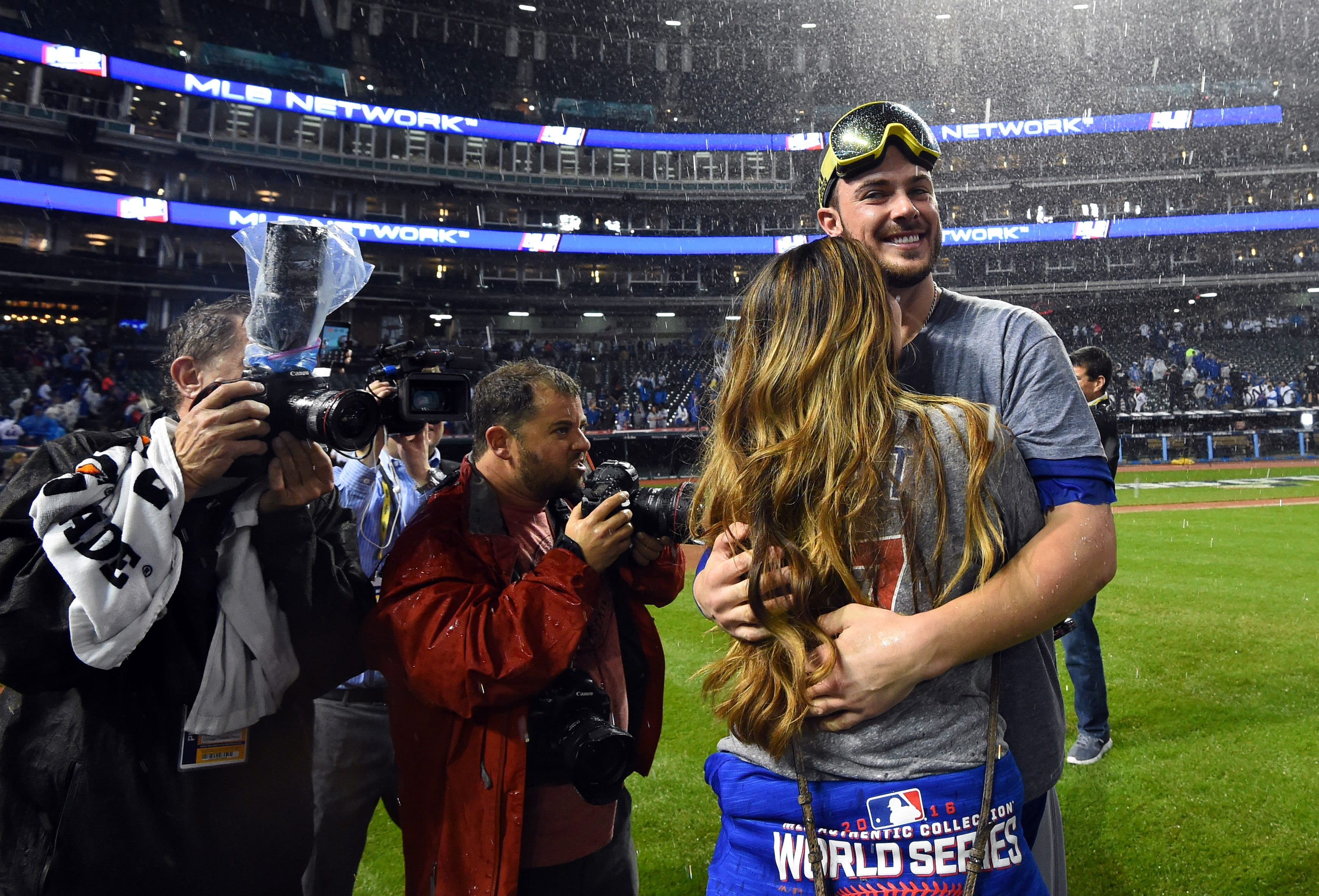 Kris Bryant celebrates winning the World Series with his fiance, who helps keep him grounded at home. (Tommy Gilligan/USA TODAY Sports)