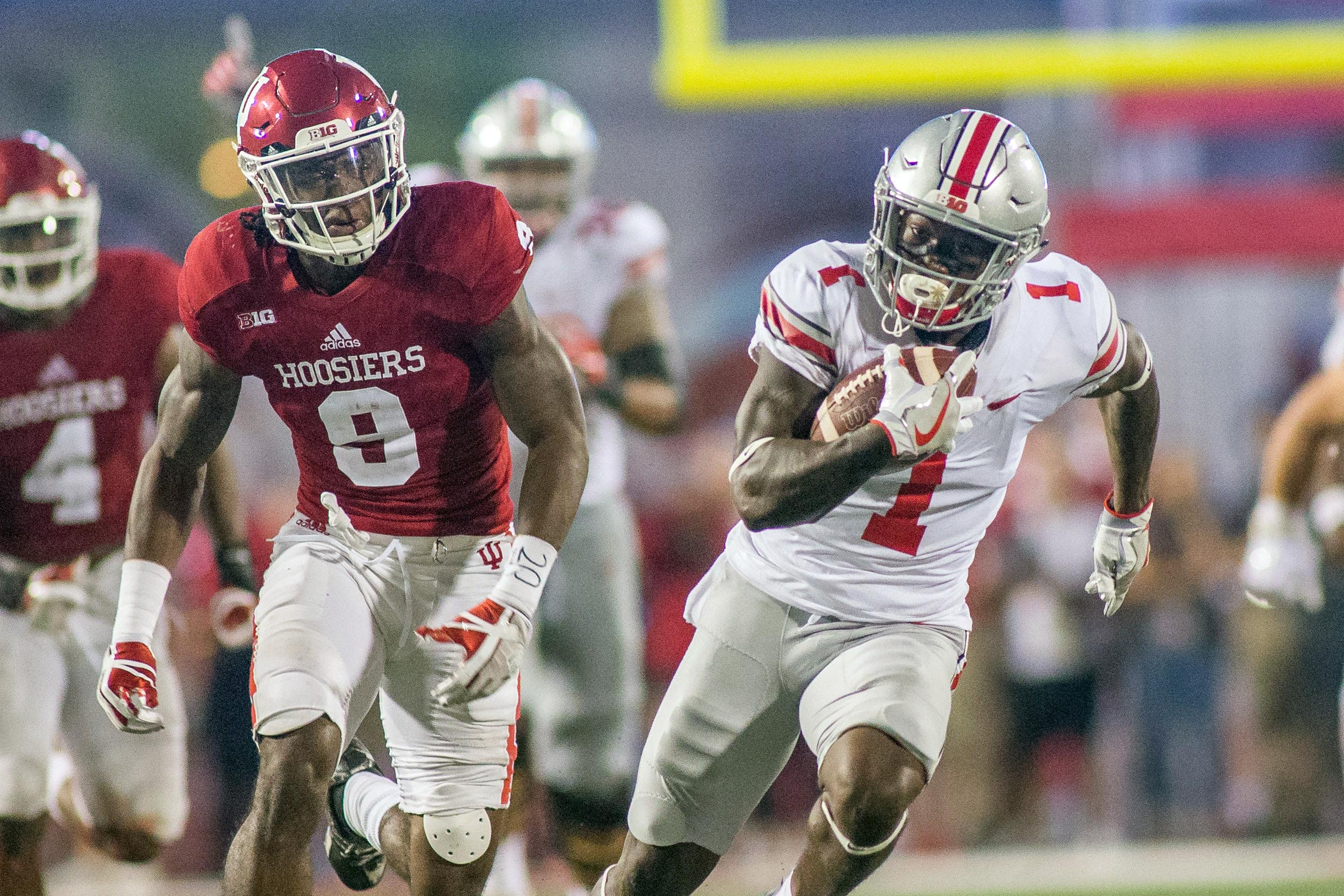 Ohio State Buckeyes wide receiver Johnnie Dixon (1) runs with the ball while Indiana Hoosiers defensive back Jonathan Crawford (9) defends in the second half of the game at Memorial Stadium. (Trevor Ruszkowski-USA TODAY Sports)