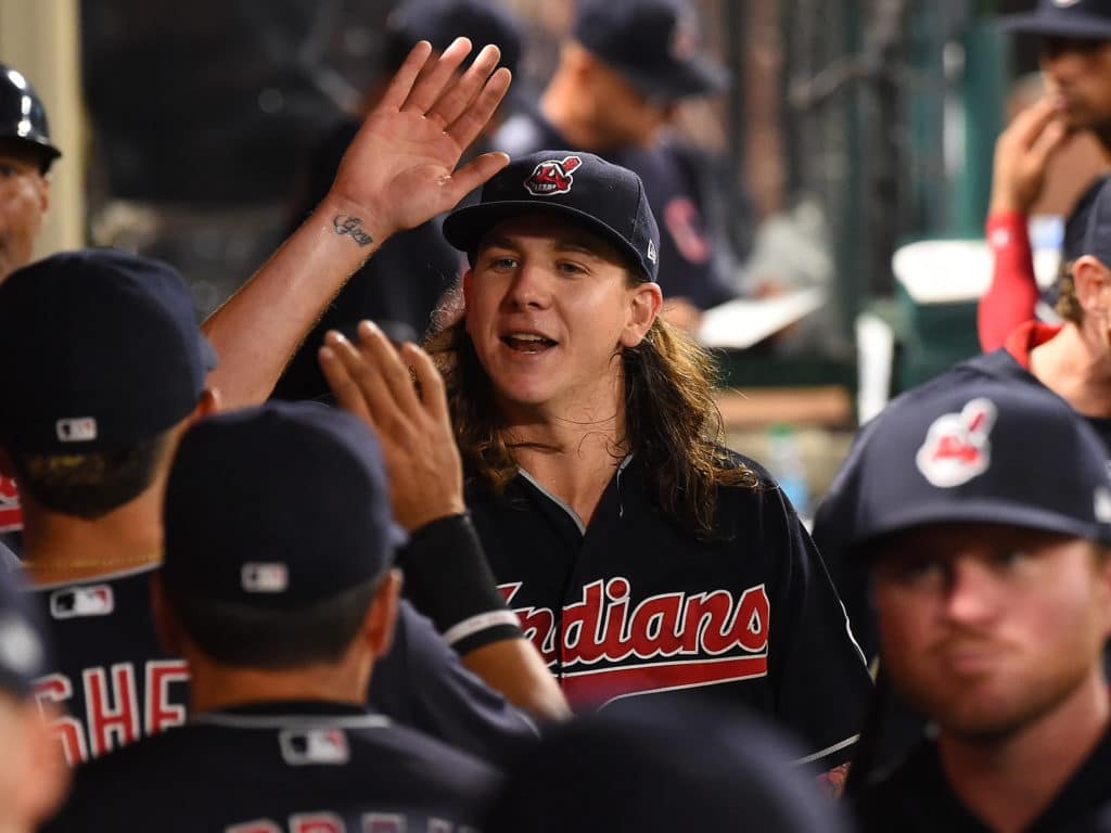 Sep 19, 2017; Anaheim, CA, USA; Cleveland Indians starting pitcher Mike Clevinger (52) is greeted in the dugout after forcing Los Angeles Angels center fielder Mike Trout (not pictured) into a double play to end the sixth inning of the game at Angel Stadium of Anaheim. Mandatory Credit: Jayne Kamin-Oncea-USA TODAY Sports