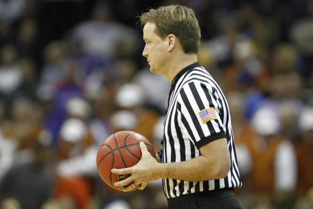 NCAA official John Higgins files federal lawsuit against Kentucky media company