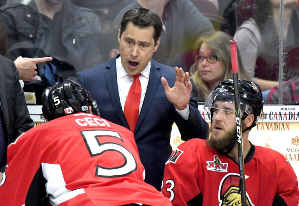 May 23, 2017; Ottawa, Ontario, CAN;  Ottawa Senators head coach Guy Boucher speaks to defenceman Cody Ceci (5) during a time out against Pittsburgh Penguins in game six of the Eastern Conference Final of the 2017 Stanley Cup Playoffs at Canadian Tire Centre. Mandatory Credit: Dan Hamilton-USA TODAY Sports