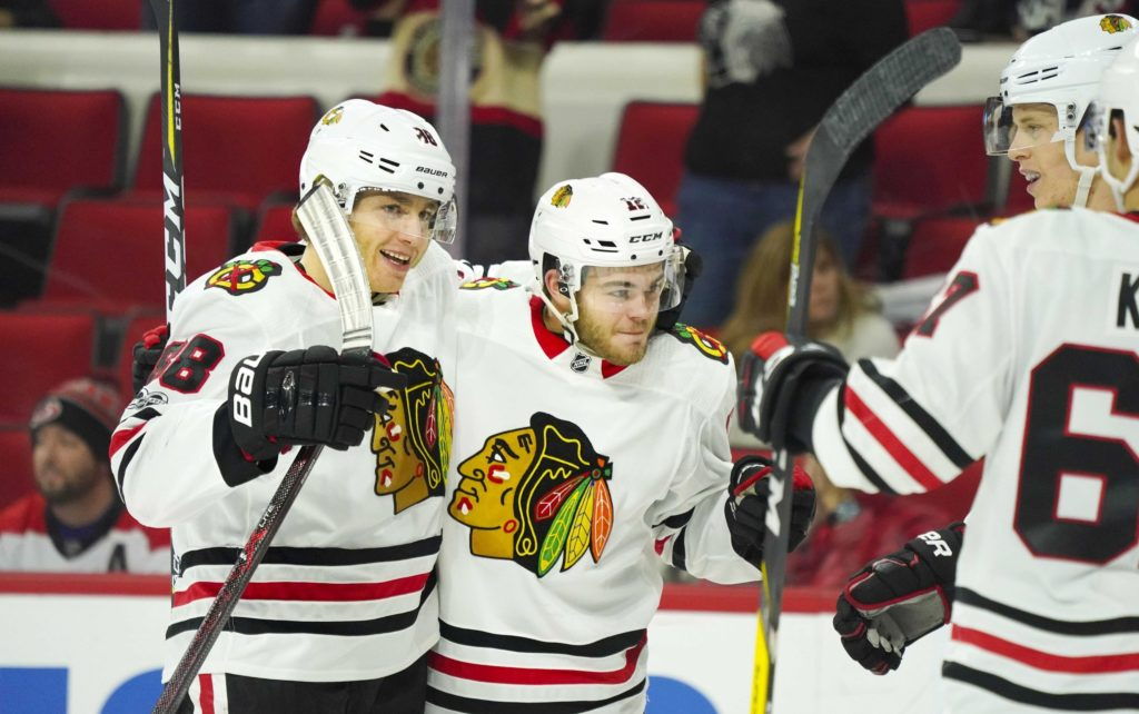 Hurricanes blow lead, fall to Blackhawks in overtime